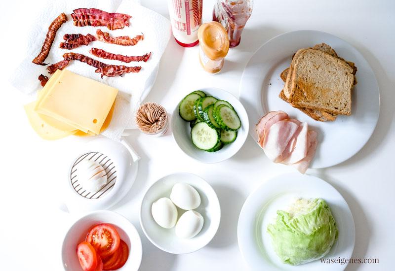 Zutaten für ein leckeres Club Sandwich: Toastbrot, Käse, Bacon, Putenwurst, Salatgurke, Tomate, Eisbergsalat, hart gekochte Eier | waseigenes.com #we #waseigenes #clubsandwich